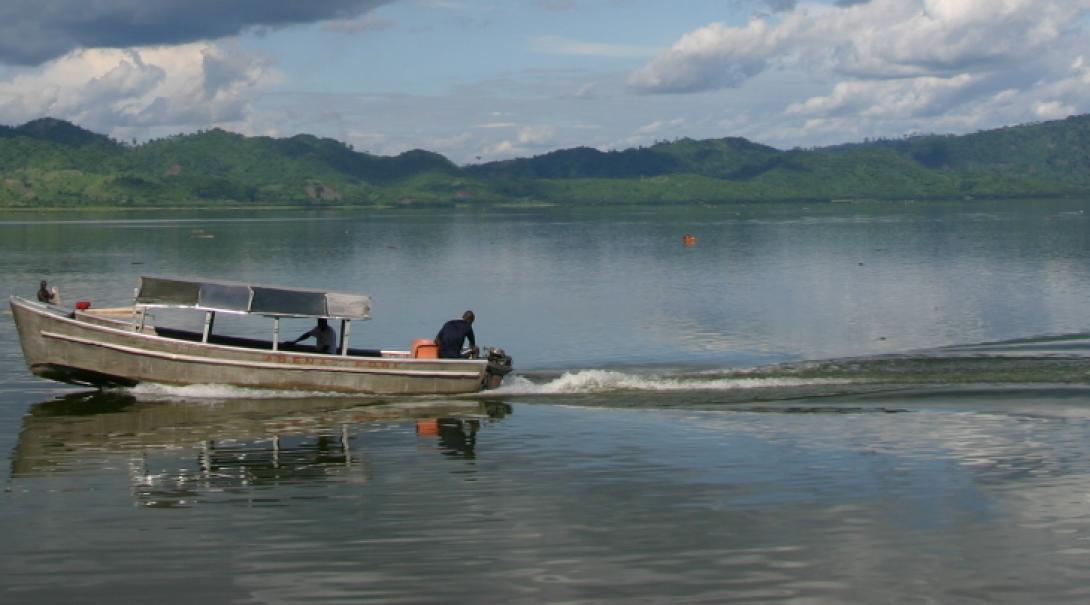 Boat travels along lake in Ghana